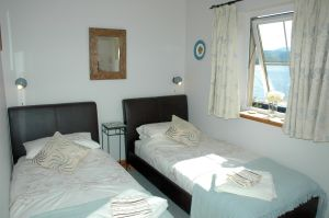Click here for more information about the bedroom in Tigh Charrann holiday apartment.