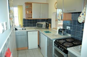 Click here for more information about the kitchen in Tigh Charrann holiday apartment.
