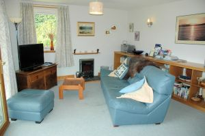 Click here for more information about the lounge in Tigh Charrann holiday apartment.