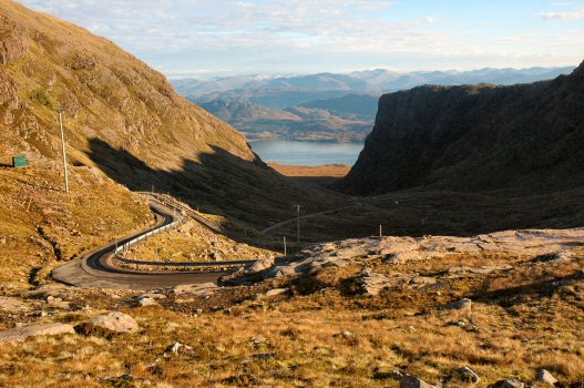 To the immediate north and west lies the Applecross peninsula which is approached via the Bealach na Ba, the Pass of the Cattle, one of the highest roads in Britain. This photo shows this road which climbs from sea level to a height of 2,053 feet over a distance of some 6 miles and provides some spectacular views along the way.